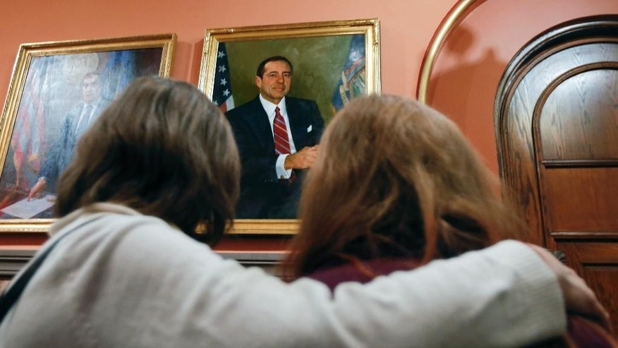 Angela Leizer, left, and her daughter, Ali, view a portrait of former New York Gov. Mario Cuomo in the Hall of Governors during a capitol tour, Friday, Jan. 2, 2015, in Albany, N.Y.  Cuomo, who served three terms as governor, died of natural causes due to heart failure, just hours after his son Andrew began his second term as New York's chief executive. He was 82. (AP Photo/Mike Groll)