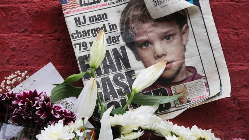 FILE - This May 28, 2012, file photo shows a newspaper with a photograph of Etan Patz that is part of a makeshift memorial in the SoHo neighborhood of New York. Jury selection is set to start Monday, Jan. 5, 2015, in Hernandez's murder trial. As the murder case surrounding Patz' notorious 1979 disappearance heads to trial, missing-children's advocates see it as proof that such cases still can be pursued after decades. (AP Photo/Mark Lennihan, File)