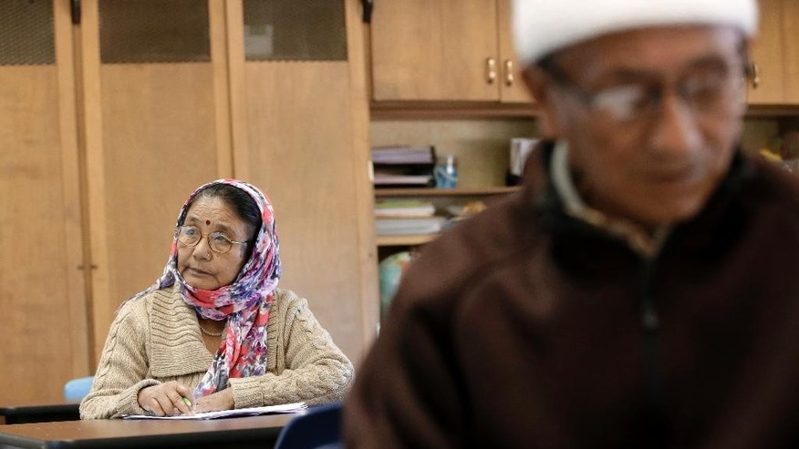 Lalita Gurung, left, of India  and Jaya B. Rai, right, from Bhutan, listen to instructions during a English as a second language class at the Alta Vista Learning Center, Tuesday, Dec. 16, 2014, in Abilene, Texas. Texas has led the nation in refugee resettlements over the last four years and continues to attract others who move to the state on their own.  (AP Photo/Tony Gutierrez)