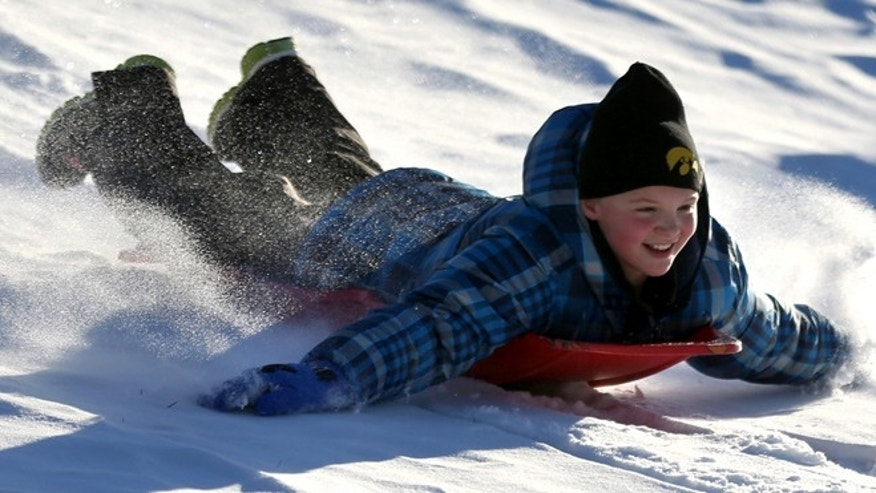 Dec. 11, 2013: Zoe Reisen,10, of Dubuque, Iowa, sleds down a hill at Allison-Henderson Park on in Dubuque, Iowa. Faced with the potential bills from people who are injured sledding, Dubuque is one of the cities across the country the is opting to close hills rather than face the risk of large liability claims.