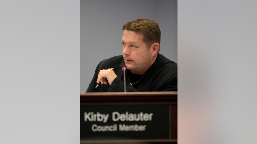 Frederick County Council member Kirby Delauter makes a point during a meeting of the recently formed 7-member council Tuesday afternoon, Jan. 6, 2015, at Winchester Hall in Frederick, Md. The Republican councilman is threatening to sue his local newspaper if they dare put his name on their pages. Delauter, who made the threat in a Facebook post lat Saturday, didn't respond Tuesday to phone and email messages. (AP Photo/The Frederick News-Post, Bill Green)
