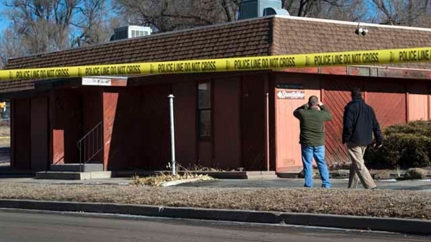 Jan. 6, 2015: Colorado Springs police officers investigate the scene of an explosion. (AP Photo/The Colorado Springs Gazette, Christian Murdock)
