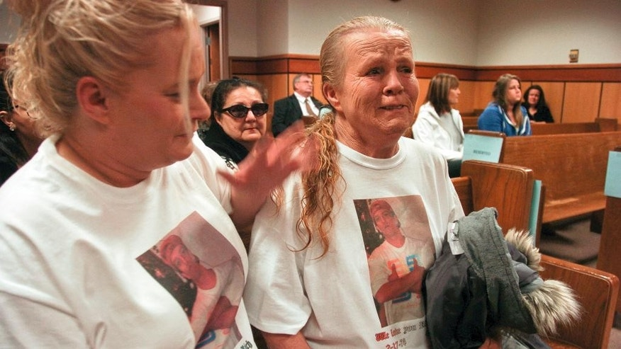 Julie Ramirez, left, consoles her mother, Betty Ramirez during a court inquest into the police shooting of Richard Ramirez in Billings, Mont. on Tuesday, Jan. 6, 2015. The unarmed man killed by Billings Police Officer Grant Morrison during a traffic stop was told repeatedly to raise his hands before Morrison shot him three times, according to video footage. The jury will decide if the shooting was justified as part of a mandatory inquest into the shooting. (AP Photo/Matthew Brown)