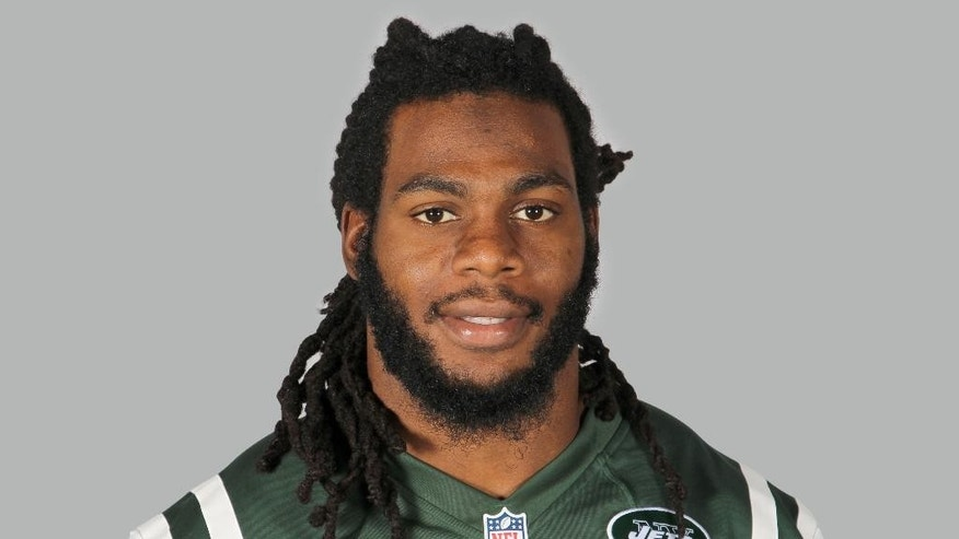 FILE - A June 16, 2014, file photo is of New York Jets linebacker Jermaine Cunningham in Forham Park, N.J.  The Union County, N.J.,  prosecutor's  office said Tuesday Jan. 6, 2015, that Cunningham has been charged with sharing explicit photos of a female friend. (AP Photo)