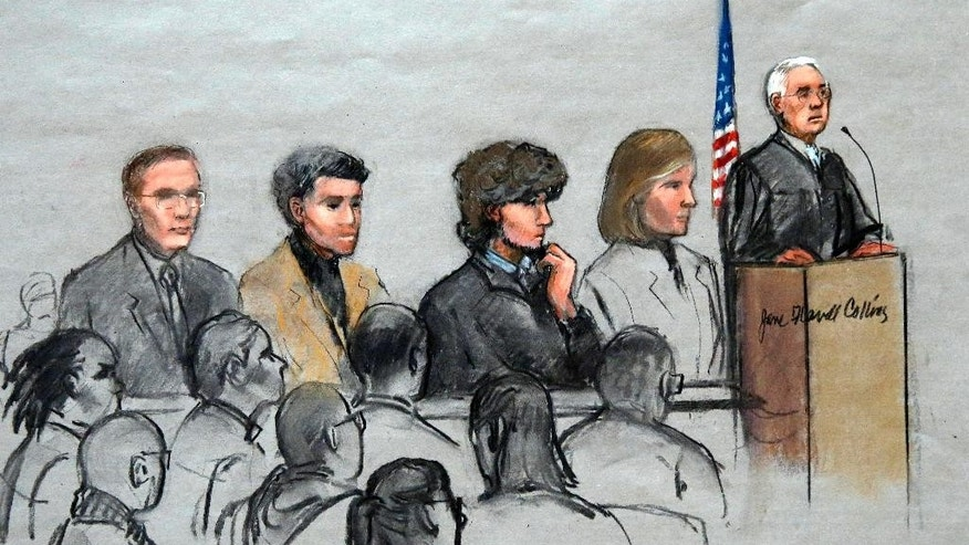 In this courtroom sketch, Boston Marathon bombing suspect Dzhokhar Tsarnaev, third from right, is depicted with his lawyers and U.S. District Judge George O'Toole Jr., right, as O'Toole addresses a pool of potential jurors in a jury assembly room at the federal courthouse, Tuesday, Jan. 6, 2015, in Boston. Tsarnaev is charged with the April 2013 attack that killed three people and injured more than 260. His trial is scheduled to begin on Jan. 26. He could face the death penalty if convicted. (AP Photo/Jane Flavell Collins)
