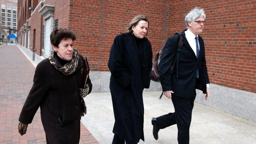 Members of the legal defense team for Boston Marathon bombing suspect Dzhokhar Tsarnaev, from left, Miriam Conrad, Judy Clarke and Timothy Watkins arrive at the federal courthouse in Boston,Tuesday, Jan. 6, 2015, on the second day of jury selection in Tsarnaev's trial. (AP Photo/Michael Dwyer)