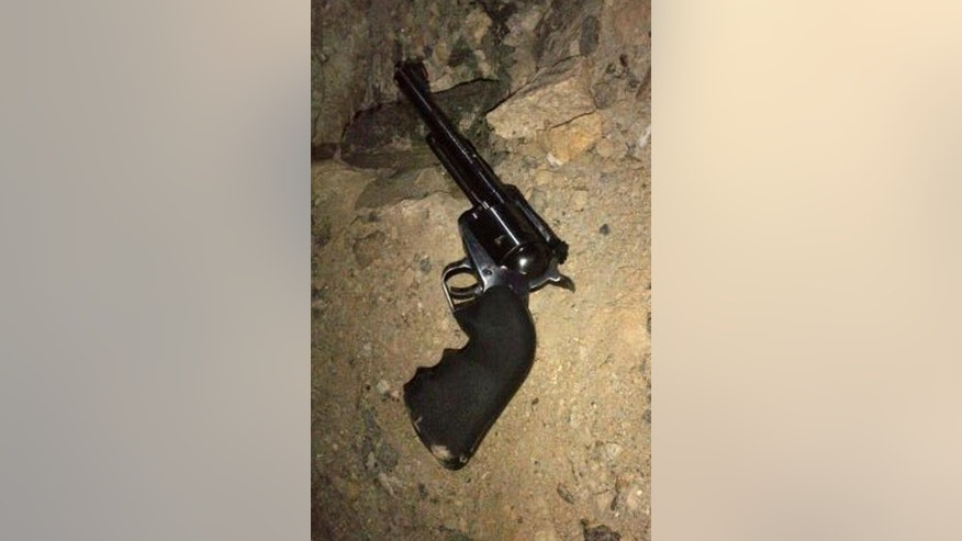 In this photo provided by the New York Police Department, an alleged suspect used this gun to fire on police officers in the Bronx borough of New York, Monday, Jan. 5, 2015. Two New York City police officers responding to a robbery in the Bronx were shot and wounded Monday night, and a manhunt was still underway hours later for a pair of suspects, authorities said. Police Commissioner William Bratton said the five plainclothes officers, part of an anti-crime unit, were in a car when they spotted two possible suspects in the robbery, one outside a Chinese restaurant and another inside it. (AP Photo/NYPD)