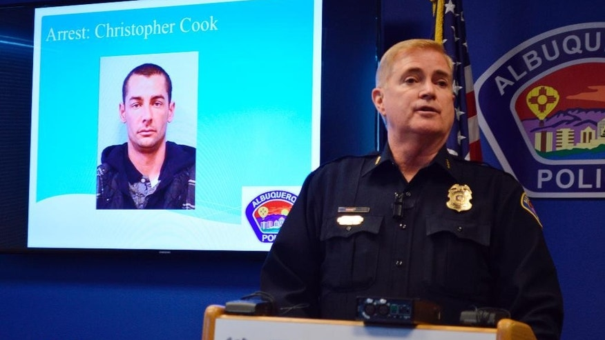 Albuquerque Police Chief Gorden Eden talks to reporters about the arrest of Christopher Cook, 36,  who is suspected of shooting Albuquerque Officer Lou Golson during a Saturday traffic stop, during a news conference Tuesday, Dec. 6, 2015, in Albuquerque, N.M. Eden says Cook, a homeless man was arrested early Tuesday. (AP Photo/Russell Contreras)
