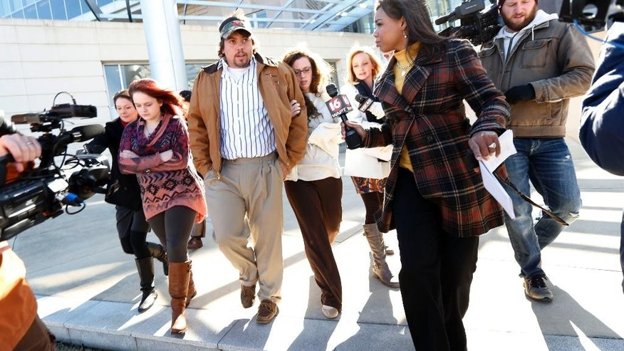 Robert Henry Rice, second from left, exits the federal courthouse in Jackson, Miss., Wednesday morning, Jan. 7, 2015, during a lunch break, prior to his change-of-plea hearing in relation to a series of 2011 racial beatings that resulted in the death of a Jackson man. Rice was indicted in 2014 at the end of a long investigation sparked by the June 2011 death of James Craig Anderson who was run over by a pickup truck outside a Jackson motel. (AP Photo/Rogelio V. Solis)