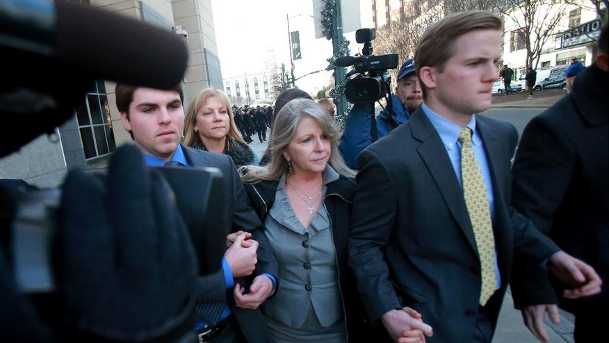 Former Virginia first lady Maureen McDonnell, center, leaves federal court with her sons, Bobby, left, and Sean after her husband, former Gov. Bob McDonnell, was sentenced to two years in federal prison for corruption charges, Tuesday, January 6, 2015, in Richmond, Va. Maureen McDonnell will be sentenced Feb. 20 for eight counts of corruption. (AP Photo/Richmond Times-Dispatch, Daniel Sangjib Min)