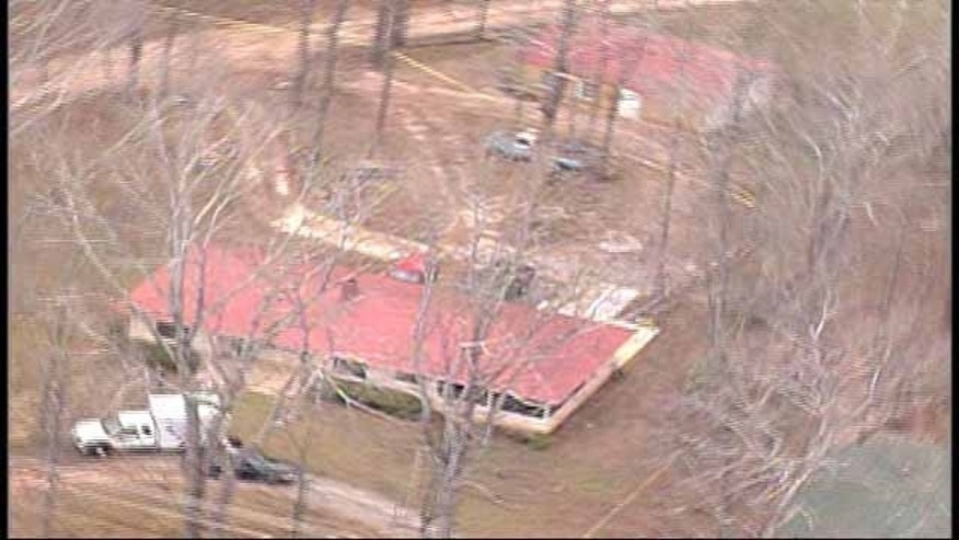 Jan. 6, 2014: Investigators examine the house where Cpl. Driskell's body was found along with those of his wife, daughter, and stepson. (MyFoxAtlanta.com)