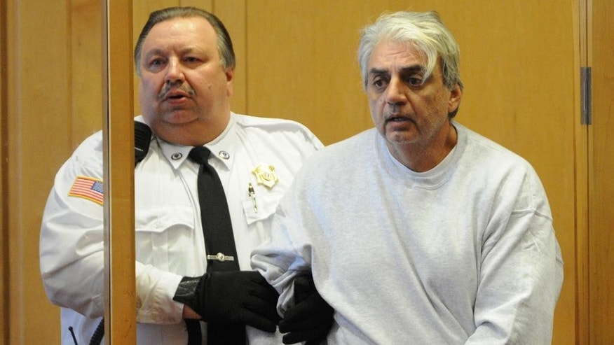 Salvatore Guglielmino, 57, of North Andover, Mass., enters the courtroom for his arraignment hearing in Lawrence District Court, Wednesday, Dec. 7, 2015, in Lawrence, Mass. According to the police, Guglielmino is accused of bludgeoning to death three men, ages 68 to 79, in their apartments in North Andover. (AP Photo/The Eagle Tribune, Paul Bilodeau, Pool)