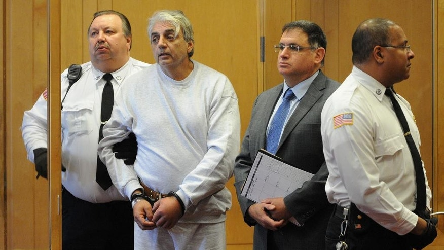 Salvatore Guglielmino, 57, of North Andover, Mass., stands with his attorney John Morris, right, during his arraignment hearing in Lawrence District Court, Wednesday, Dec. 7, 2015, in Lawrence, Mass. According to the police, Guglielmino is accused of bludgeoning to death three men, ages 68 to 79, in their apartments in North Andover. (AP Photo/The Eagle Tribune, Paul Bilodeau, Pool)