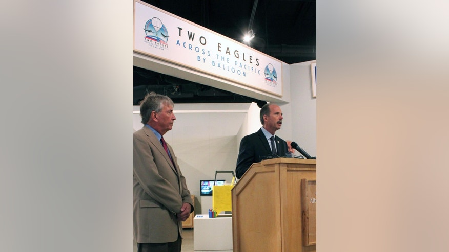Albuquerque Mayor Richard Berry, right, and Steven Shope, director of the Two Eagles ballooning command center provide an update on launch plans during a news conference in Albuquerque, N.M., on Thursday, Jan. 8, 2015. The international Two Eagles team plans to launch from the coast of southern Japan and head toward North America in hopes of breaking a pair of major ballooning records. (AP Photo/Susan Montoya Bryan)