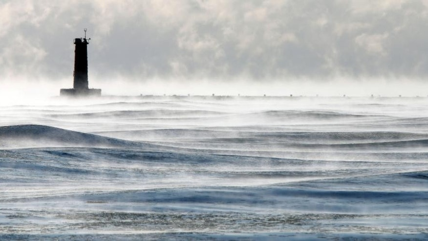 The Lighthouse is mired in the depth of winter's chill along Lake Michigan as seen Wednesday Jan. 7, 2015 in Sheboygan, Wisc.  Cold weather is expected to stay around for a few days. (AP Photo/Sheboygan Press Media, Gary C. Klein)