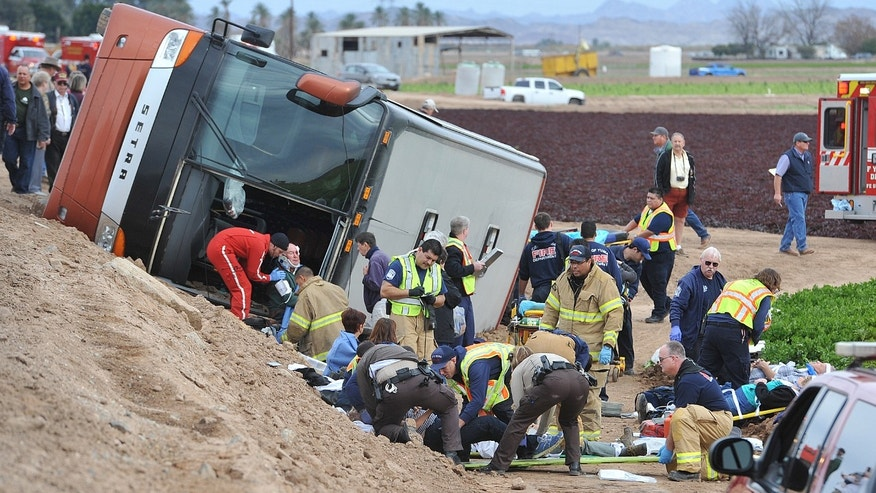Jan. 8, 2015: Emergency personnel tend to victims of a tour bus crash on an agricultural sightseeing trip Thursday morning.