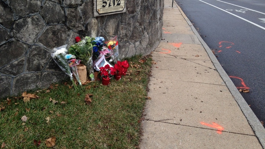 Dec. 29, 2014 - The scene of a fatal collision between a car and bicyclist along a Baltimore residential street with a bike lane. Maryland Bishop Suffragan Heather Cook will be charged with vehicular manslaughter, drunken driving and texting in a hit-and-run crash that killed the bicyclist, Baltimore's top prosecutor said Friday.