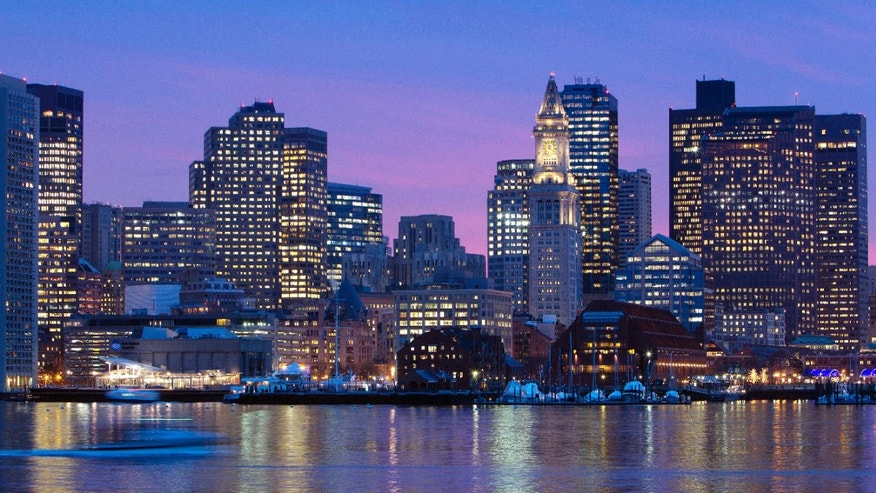 Jan. 6, 2012: The Boston city skyline is illuminated at dusk as it reflects off the waters of Boston Harbor