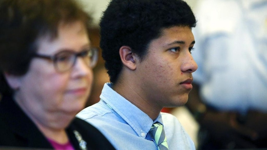 FILE - In this Aug. 12, 2014, file photo, Philip Chism, right, sits with attorney Denise Regan, left, during a hearing in Essex County Superior Court in Salem, Mass. Chism, 15, has been charged as an adult with murder and aggravated rape in the October 2013 slaying of Colleen Ritzer, math teacher at Danvers High School. Chism's public defender, Regan, is expected to argue in Essex County Superior Court on Friday, Jan. 9, 2015, that police never properly read Chism his Miranda rights and continued to question Chism even after he had invoked his right to remain silent and his mother had asked for a lawyer. (AP Photo/The Salem News, Ken Yuszkus, Pool, File)