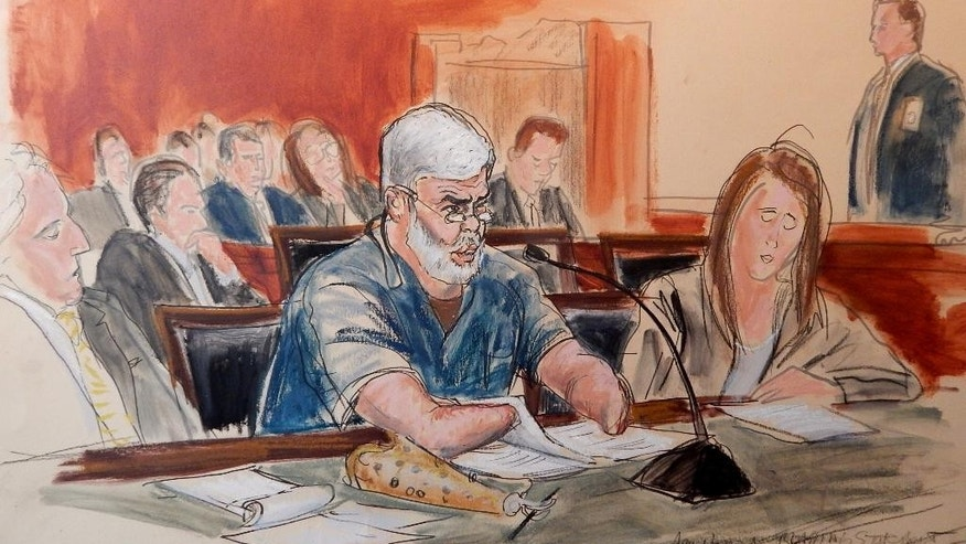 In this courtroom sketch Mustafa Kamel Mustafa, 56, makes a statement to the judge, flanked by his defense attorneys, Sam Schmidt, left, and Lindsay Lewis address the court during Mustafa's sentecing Friday, Jan 9, 2015, in New York where Mustafa, an Islamic cleric convicted of terrorism charges in a 1998 kidnapping that killed four tourists in Yemen and in failed plans to build a terrorist training camp in the U.S. was sentenced to life in prison. Mustafa's lawyers had urged the judge to take into account that he is missing hands and forearms from what he described from the witness stand as a 1993 engineering accident involving explosives. He also suffers from psoriasis, diabetes and high blood pressure. But U.S. District Judge Katherine Forrest said she will not prejudge the ability of the Federal Bureau of Prisons to properly evaluate Mustafa's needs and to designate an appropriate prison. (AP Photo/Elizabeth Williams)