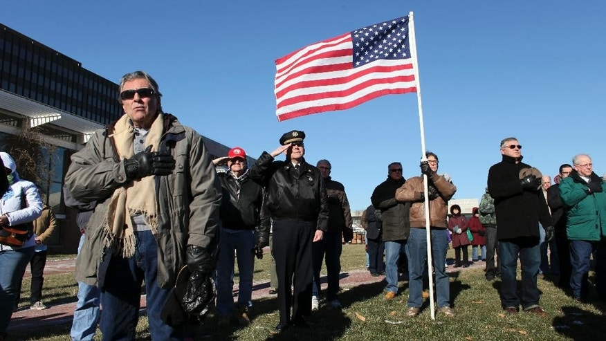 People sing the National Anthem during a pro-police rally, Saturday, Jan. 10, 2015, on Independence Mall in Philadelphia.  Organizers called the gathering the Delaware Valley Pro-Blue Rally and said that the event was in remembrance of fallen New York City police officers Rafael Ramos and Wenjian Liu. (AP Photo/ Joseph Kaczmarek)