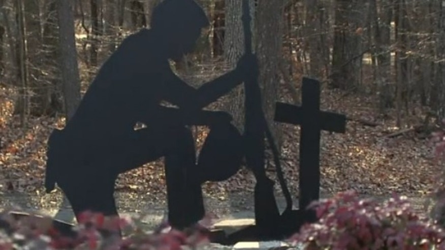 King city officials voted to remove this sculpture depicting a soldier kneeling in prayer before a cross to settle a lawsuit claiming the artwork promoted Christianity.