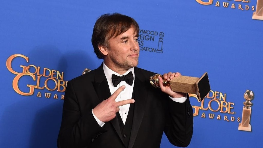 "Richard Linklater poses in the press room with the award for best director for ""Boyhood"" at the 72nd annual Golden Globe Awards at the Beverly Hilton Hotel on Sunday, Jan. 11, 2015, in Beverly Hills, Calif. (Photo by Jordan Strauss/Invision/AP)"