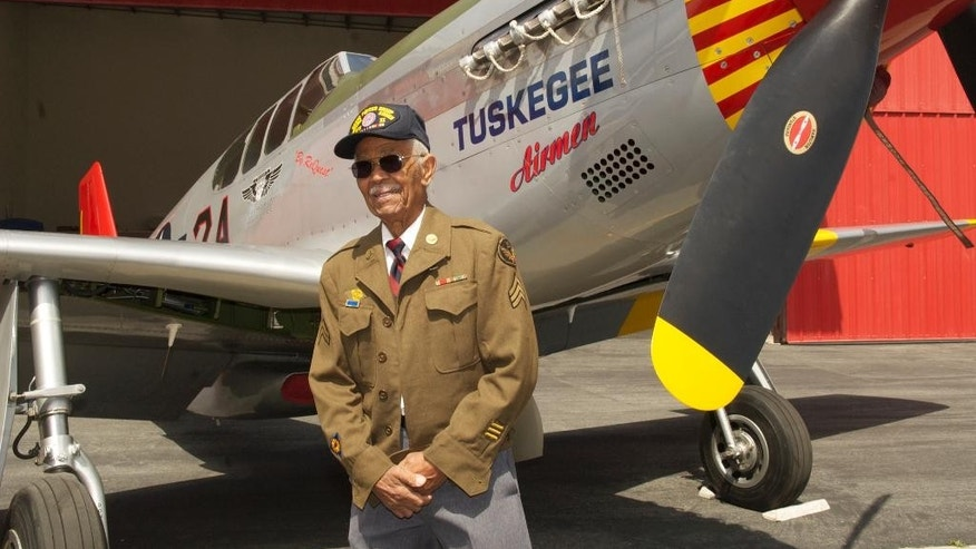"This April 7, 2011 photo by Bruce Talamon shows Clarence E. ""Buddy"" Huntley Jr., a member of the Tuskegee Airmen, the famed all-black squadron that flew in World War II, posing with a P-51C Mustang fighter plane similar to the one that he was a crew chief on while overseas during the war, at Torrance, Calif., Airport. Huntley and fellow Tuskegee Airman Joseph Shambrey, lifelong friends who enlisted together, both died on the same day, Monday, Jan. 5, 2015, in their Los Angeles homes, relatives said Sunday, Jan. 11, 2015. Both were 91. Huntley and Shambrey enlisted in 1942 and were shipped overseas to Italy in 1944 with the 100th Fighter Squadron of the Army Air Force's 332nd Fighter Group. As mechanics, they kept the combat planes flying.(AP Photo/Bruce Talamon (c) 2011 All Rights Reserved)"