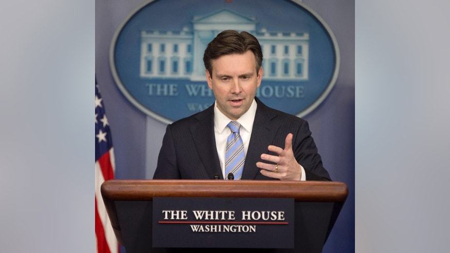 White House press secretary Josh Earnest speaks to the media during the daily briefing in the Brady Press Briefing Room of the White House, Monday, Jan. 12, 2015. Earnest said the White House erred in not sending higher level official to the anti-terror march in Paris. (AP Photo/Pablo Martinez Monsivais) (AP Photo/Pablo Martinez Monsivais)