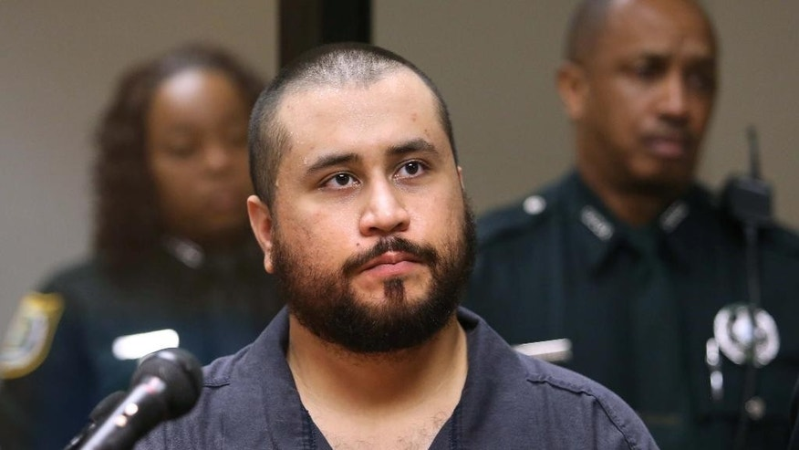 Nov. 19,  2013: George Zimmerman listens in court, in Sanford, Fla., during his hearing on charges including aggravated assault stemming from a fight with his girlfriend. (AP/Orlando Sentinel, Joe Burbank, Pool, File)