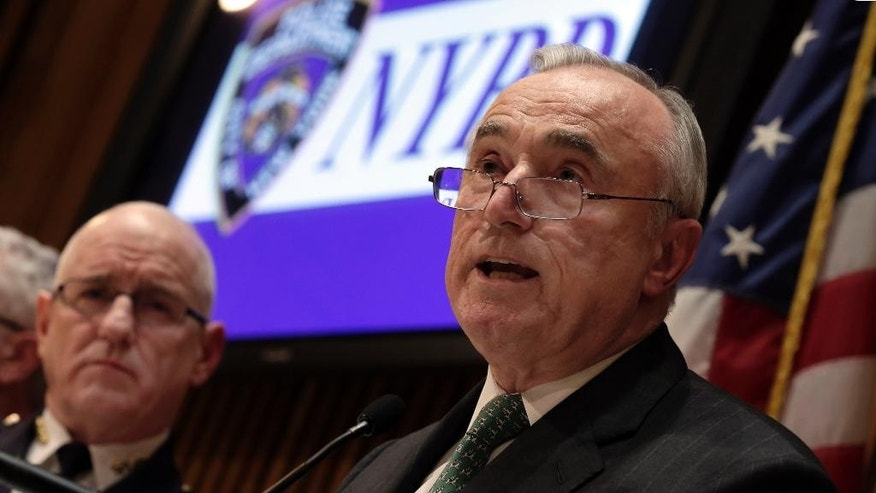 New York City Police Commissioner William Bratton, right, with NYPD Chief of Transit Joseph Fox, addresses a news conference at police headquarters, in New York,  Monday, Jan. 12, 2015. There are signs that disgruntled officers have started making more low-level arrests, New York Police Department officials said Monday. NYPD statistics show arrests were up in the past week after plummeting in the weeks following the fatal ambush of two patrolmen in December.(AP Photo/Richard Drew)