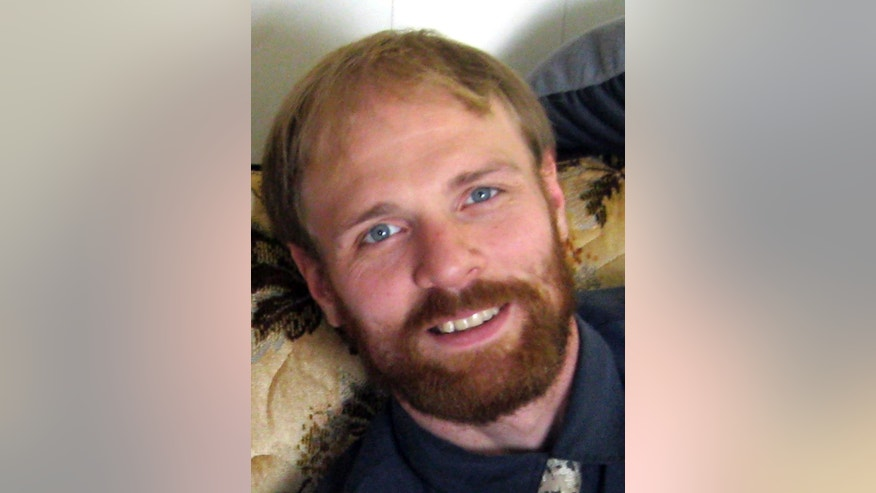 In this 2014 photo provided by Gary Lentzkow is his son Matthew Lentzkow in La Porte City, Iowa. Lentzkow, 36, of Newton, died on Nov. 1 in a traffic accident on Interstate 80 after managing to escape from an Iowa State Patrol car while handcuffed. (AP Photo/Gary Lentzkow)