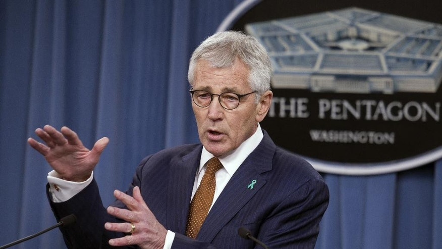 FILE - In this Dec. 4, 2014 file photo, Defense Secretary Chuck Hagel speaks at the Pentagon. Hagel is opening a farewell tour to thank troops for their service as he prepares to turn over his duties to his designated successor, Ashton Carter. Hagel arrived Tuesday at Whiteman Air Force Base in western Missouri to speak with B-2 stealth bomber crews. (AP Photo/Cliff Owen, File)