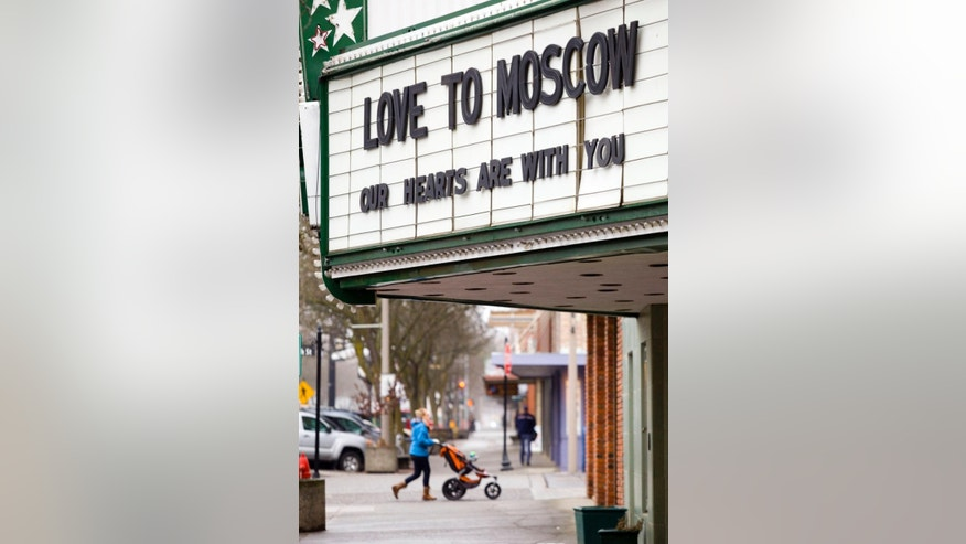 "The marquee at the Kenworthy Performing Arts Centre reads ""Love to Moscow, our hearts are with you"" in Moscow, Idaho, on Monday, Jan. 12, 2015. The message is in response to the shooting deaths of three Moscow residents on Saturday, Jan. 10. (AP Photo/Moscow-Pullman Daily News, Geoff Crimmins)"