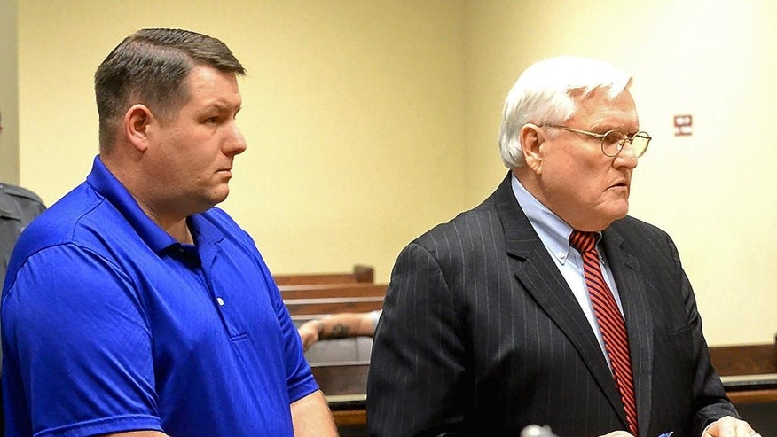 FILE - In a Thursday, Dec. 4, 2014 file photo, Richard Combs, left, the former police chief and sole officer in the small town of Eutawville, S.C., listens in court with his lawyer John O'Leary, in Orangeburg, S.C. Solicitor David Pascoe said in opening arguments Wednesday, Jan. 7, 2015 that Bernard Bailey was murdered over a broken taillight by then-Eutawville Police Chief Combs. But Combs' lawyer O'Leary says the chief had a legitimate warrant against Bailey, and the victim turned his pickup truck into a weapon when he tried to back away as Combs tried to arrest him. (AP Photo/The Times and Democrat, Larry Hardy, File)