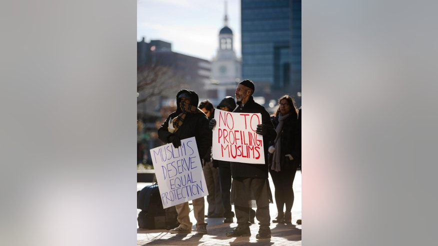 Protesters demonstrate, in view of Independence Hall, after Muslim residents of New Jersey were in court to try to reverse a ruling that found New York City police could legally monitor their activities, Tuesday, Jan. 13, 2015, outside the U.S. Courthouse in Philadelphia. Two civil rights groups, Muslim Advocates and the Center for Constitutional Rights, argued their appeal Tuesday before the 3rd U.S. Circuit Court of Appeals in Philadelphia. The plaintiffs include a U.S. soldier, a school principal and several Rutgers University students. (AP Photo/Matt Rourke)