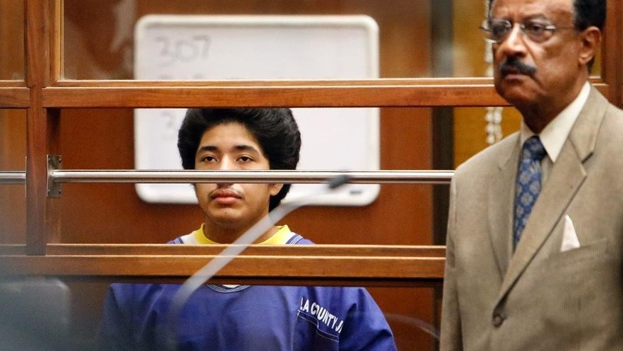 Jonathan Del Carmen, left, appears in Los Angeles Superior Court Monday, Jan. 12, 2015, with his attorney Marvin J. Hamilton Jr., as one of four defendants being charged in connection to the 2014 beating death of USC graduate student Xinran Ji student during an attempted robbery. (AP Photo/Los Angeles Times, Al Seib, Pool)
