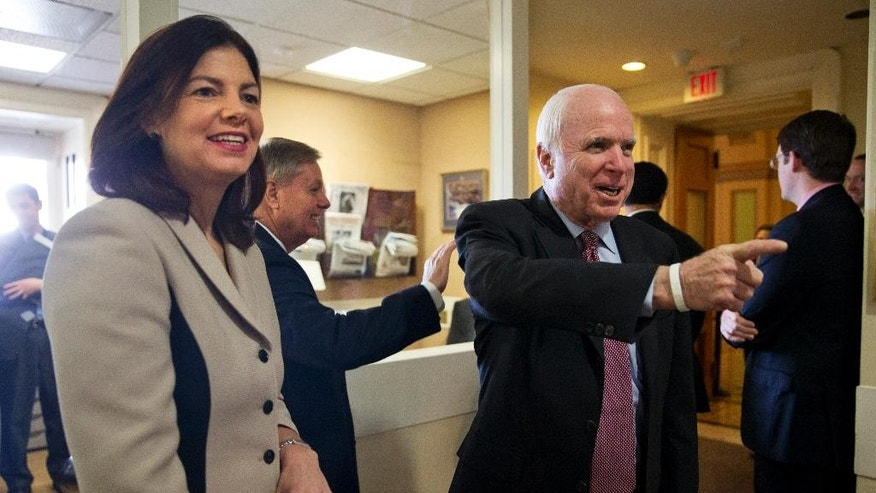 From left, Sen. Kelly Ayotte, R-N.H., Sen. Lindsey Graham, R-S.C., and Senate Armed Services Committee Chairman Sen. John McCain, R-Ariz., arrive before a news conference on Capitol Hill in Washington, Tuesday, Jan. 13, 2015, to discuss the federal prison at Guantanamo Bay, Cuba. Four powerful Republican senators are pushing for new restrictions on President Barack Obama's ability to transfer terror suspects out of the federal prison at Guantanamo Bay, Cuba. (AP Photo/Jacquelyn Martin)