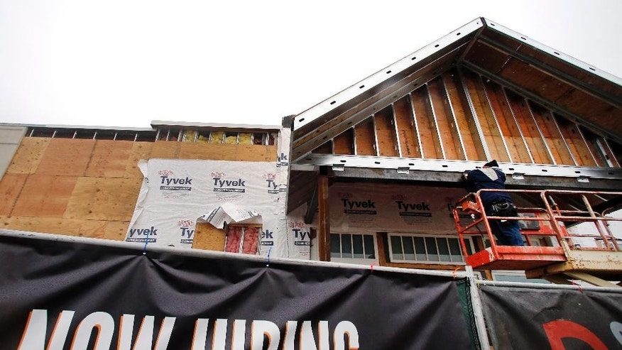 In this Jan. 12, 2015 photo, construction continues on a commercial property in Peabody, Mass.  The Federal Reserve releases its latest 'Beige Book' survey of economic conditions on Wednesday, Jan. 14, 2015. (AP Photo/Elise Amendola, File)