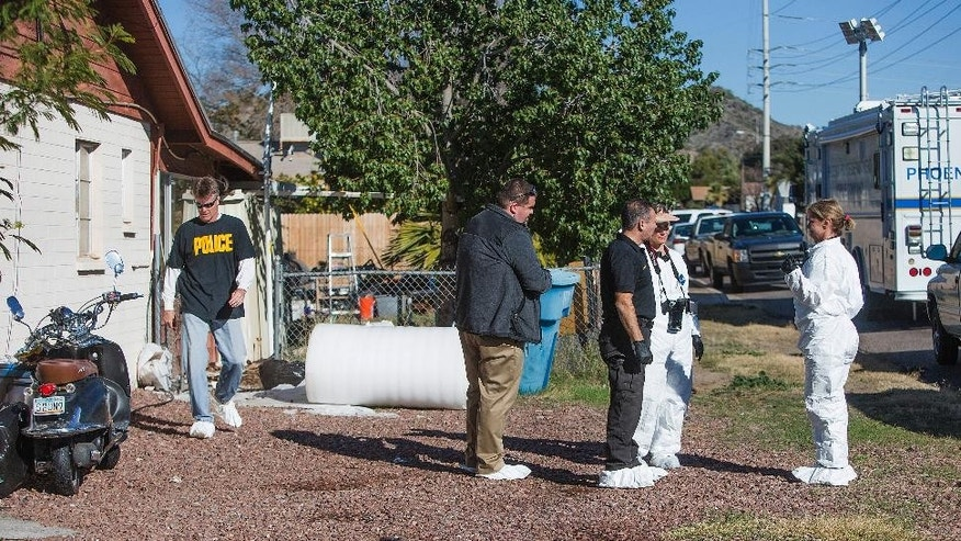 Phoenix Police Crime Response Unit members inspect the house of a man suspected of at least two 1992 murders of two young women on Wednesday, Jan. 14, 2015 in Phoenix, Ariz. Police arrested 42-year-old Bryan Patrick Miller late Tuesday in the deaths of 22-year-old Angela Brosso and 17-year-old Melanie Bernas.  Brosso was killed in November 1992, and Bernas was killed in September 1993. Their remains were found in or near the Arizona canal. Both had disappeared while bicycling in the area.  (AP Photo/The Arizona Republic, Tom Tingle)  MARICOPA COUNTY OUT; MAGS OUT; NO SALES