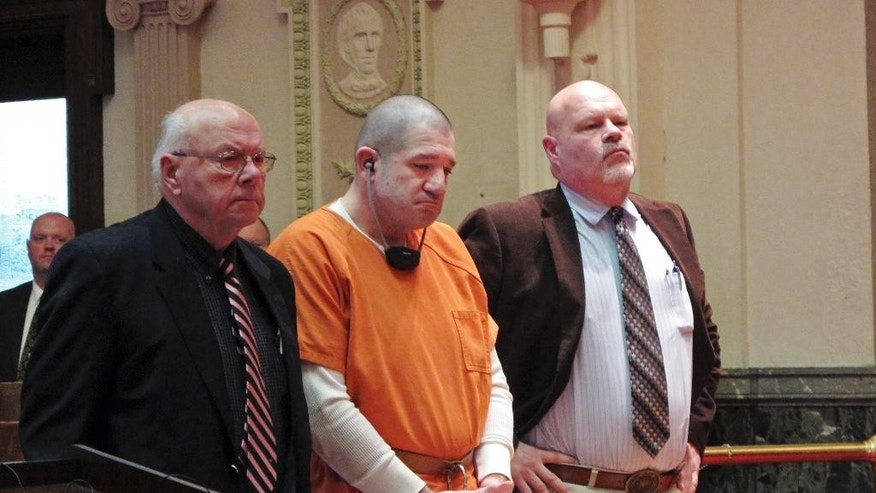 Donald Hoffman, 41, stands between defense attorneys Robert Whitney, left, and Rolf Whitney as he pleads guilty to aggravated murder in a deal with prosecutors Wednesday, Jan. 14, 2015, in Bucyrus, Ohio. Hoffman, charged with killing four men last fall while on a cocaine binge, was sentenced to life in prison. (AP Photo/Kantele Franko)