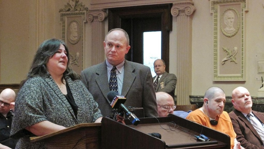 Donna Hardymon, left, addresses the court with support from a victim advocate at a hearing  for Donald Hoffman, second from right, Wednesday, Jan. 14, 2015 in Bucyrus, Ohio. Hoffman, who who was charged with killing Hardymon's father and three other men, was sentenced to life in prison after pleading guilty to aggravated murder in a plea deal. (AP Photo/Kantele Franko)