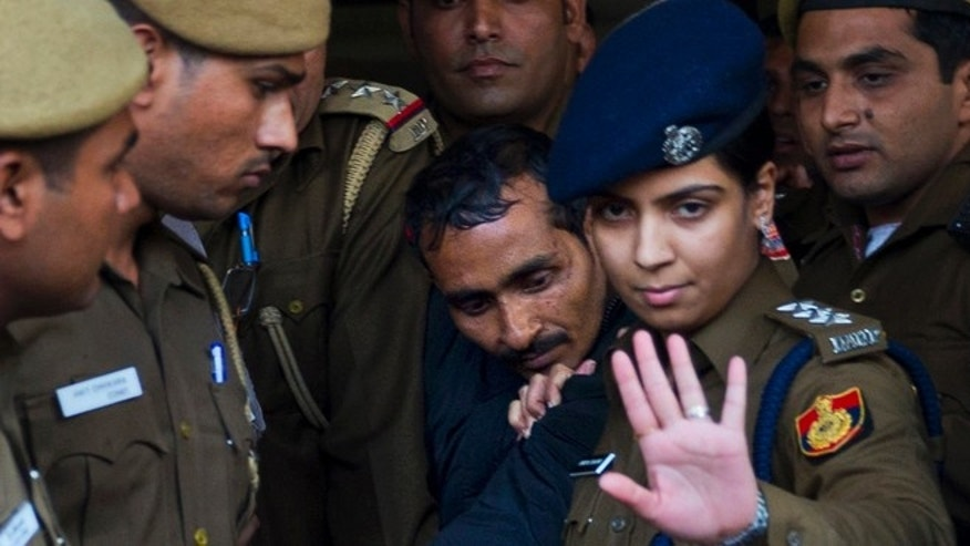Dec. 8, 2014: 32-year-old Shiv Kumar Yadav, center, a driver from the international car service Uber, is escorted by police to be produced to a court in New Delhi, India. (AP)