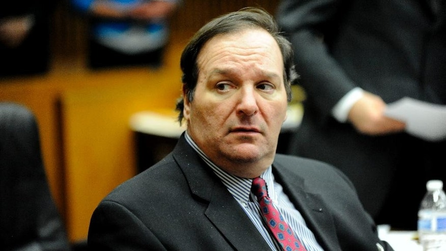 "FILE - In this Dec. 10, 2014, file photo, Robert Bashara sits in court at Frank Murphy Hall of Justice in Detroit. Bashara was convicted of arranging the murder of his wife so he could live the life of a bondage ""master"" is facing a mandatory sentence of life in prison without parole. He is returning to Wayne County court Thursday, Jan. 15, 2015, about a month after his conviction and nearly three years after Jane Bashara was found dead in her Mercedes-Benz in a Detroit alley. (AP Photo/Detroit News, David Coates, File)"