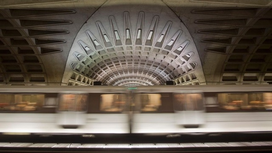 Jan. 13, 2015: A subway train departs the L'Enfant Metro Station in Washington. The NTSB is investigating an electrical malfunction that filled the station with smoke, killing one woman and sending dozens of people to hospitals. (AP Photo/Pablo Martinez Monsivais)