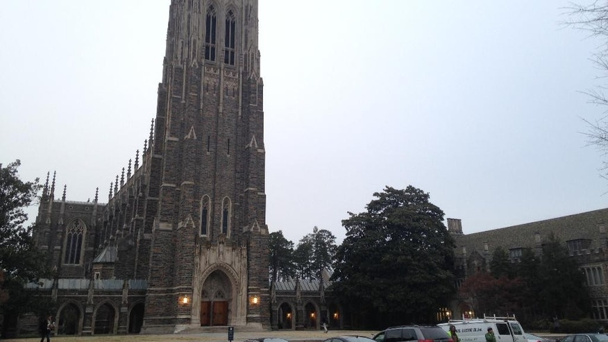 This Thursday, Jan. 15, 2015 photo shows Duke Chapel in Durham, N.C. On Thursday, just days after announcing that a traditional Muslim call to prayer would echo from the historic chapel tower, Duke University changed course after being bombarded with calls and emails objecting to the plan. Instead, Muslims will gather for their call to prayer in a grassy area in front of the chapel before heading into a room in the chapel for their weekly prayer service on Friday. (AP Photo/Jonathan Drew)
