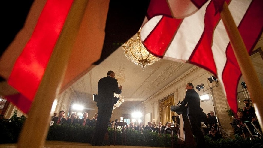 President Barack Obama and British Prime Minister David Cameron hold a joint news conference in the East Room of the White House in Washington, Friday, Jan. 16, 2015. The president and prime minister agreed Friday to a joint effort to fight domestic terrorism after last week's deadly attacks in France. (AP Photo/Carolyn Kaster)