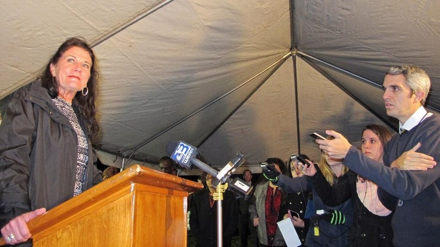 Cecilia McAdams addresses reporters outside Florida State Prison after the execution of Johnny Shane Kormondy. Kormondy, 42, was the ringleader of a 1993 Panhandle home-invasion robbery that left McAdams' husband, Gary McAdams, dead, in Starke, Fla., Thursday, Jan. 15, 2015. (AP Photo/Jason Dearen)
