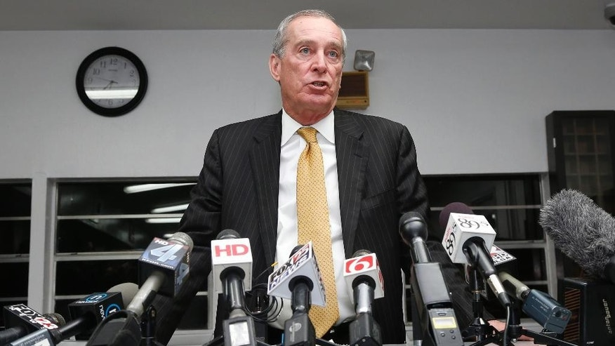 Jerry Massie, spokesman for the Oklahoma Department of Corrections, announces the time of death of inmate Charles Warner to the media at the Oklahoma State Penitentiary in McAlester, Okla., Thursday, Jan. 15, 2015.  Warner was executed for the murder and rape of 11-month old Adriana Waller in 1997 in Oklahoma City. (AP Photo/Sue Ogrocki)
