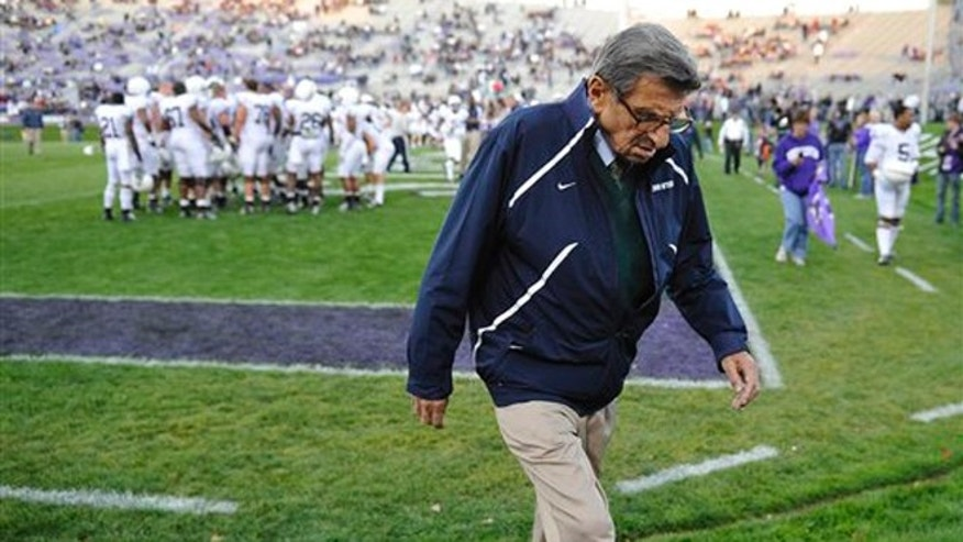 Oct. 22, 2011: In this file photo, Penn State coach Joe Paterno walks off the field after warmups before an NCAA college football game against Northwestern in Evanston, Ill.